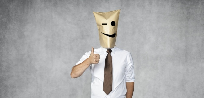 ignorant businessman with a smiley face bag over his head